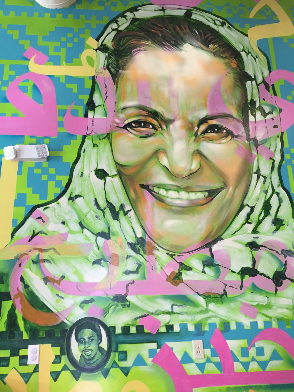 Mural of Rasmea Odeh and Oscar Grant at Reem's. PC: Nina Adarkar