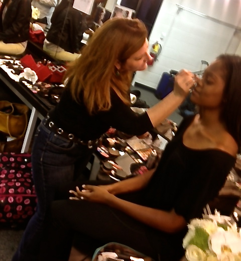 Makeup Artist Kiev Osborne working backstage at Atlanta's Apparel Mart.