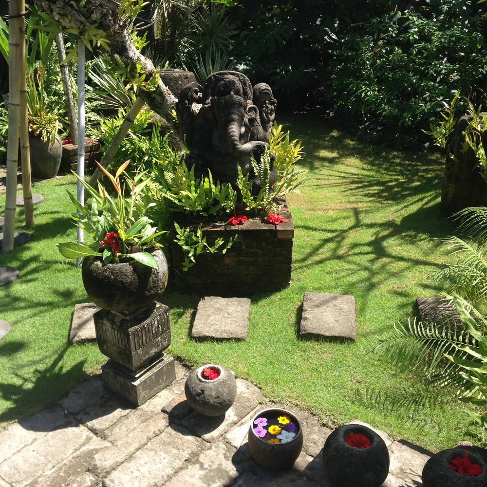 Sunny Canggu. Ganesha at Desa Seni with lots of floating flowers.
