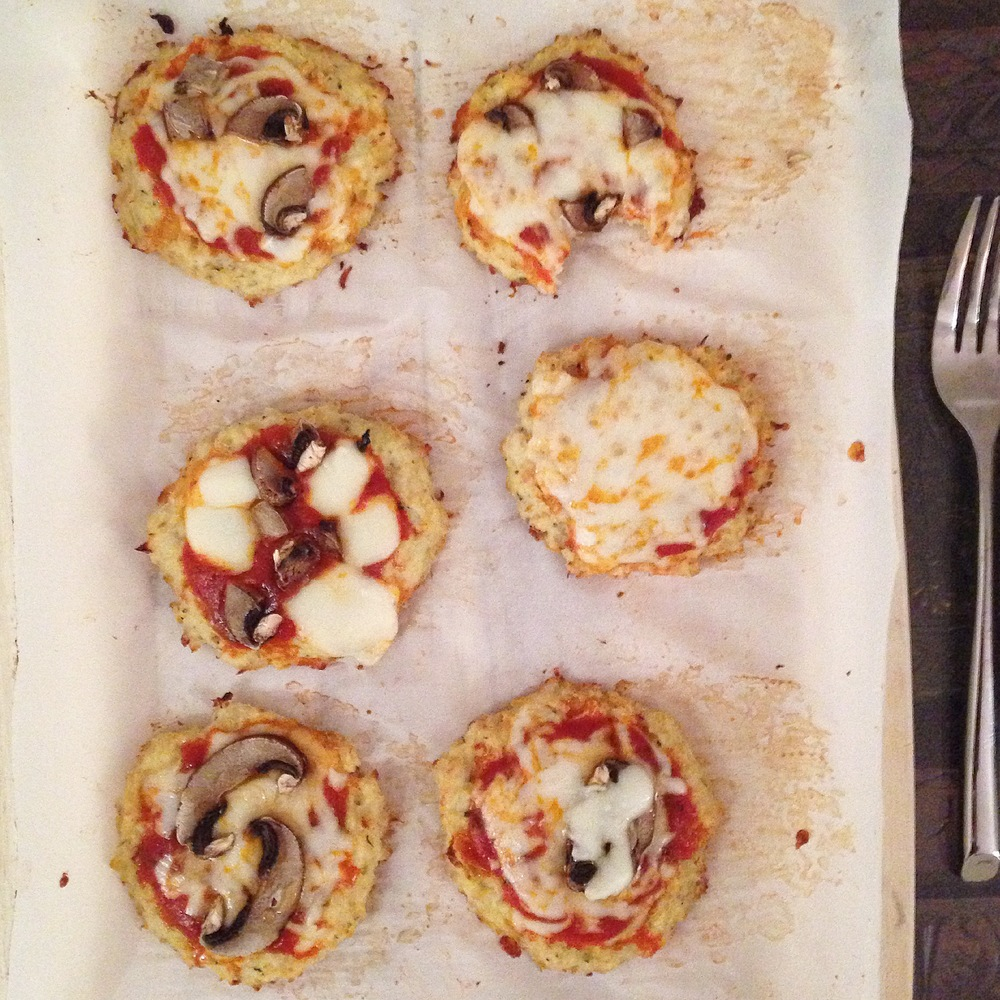 Taste testing some delicious litte mini pizzas. There weren't any leftovers.