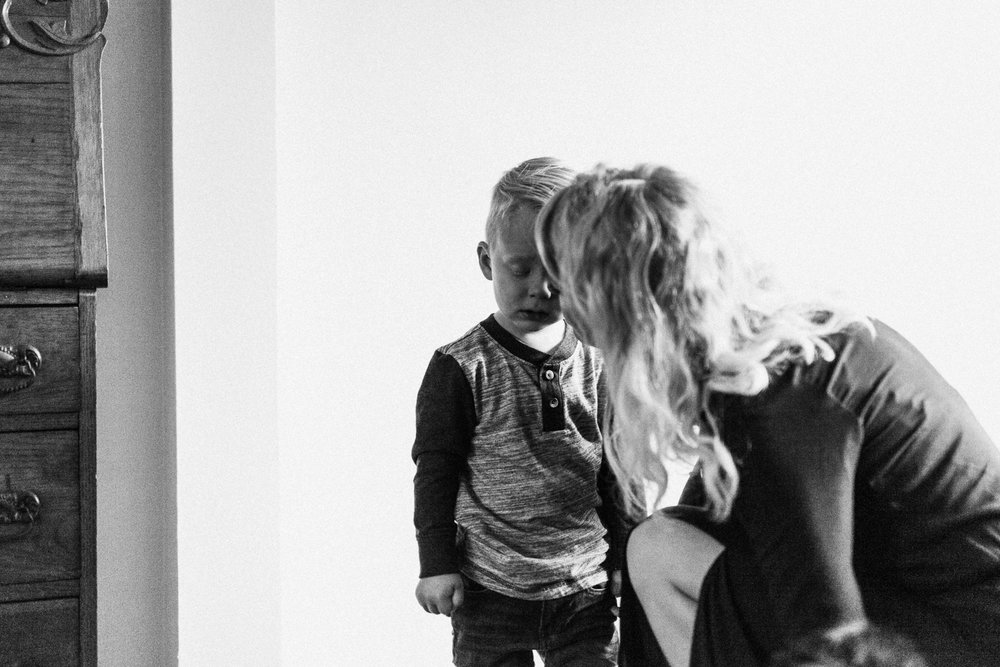 candid and raw black and white portrait of mom and son slc utah