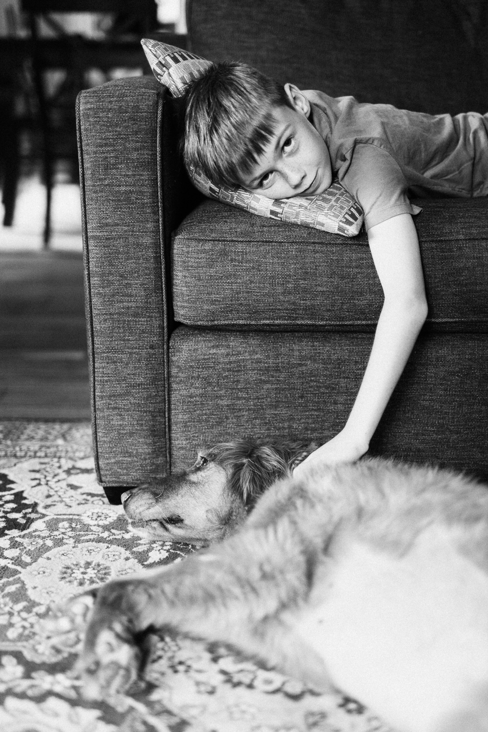 black-and-white-portrait-of-boy-and-dog-at-home-photography-shoot-new-york-city-ny