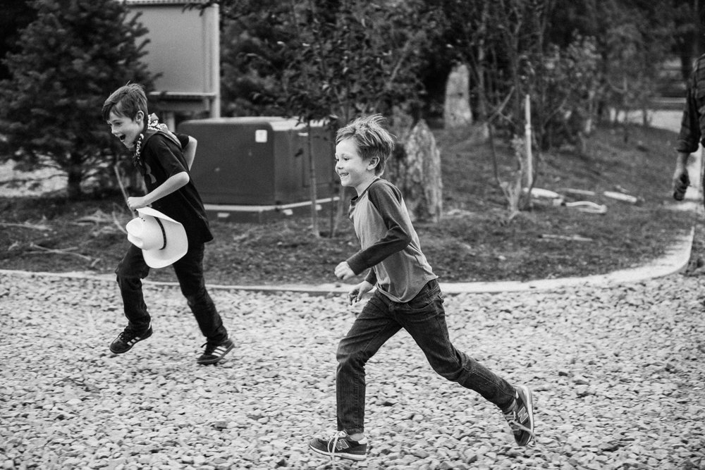 candid-black-and-white-photograph-of-young-boys-running-in-heber-utah