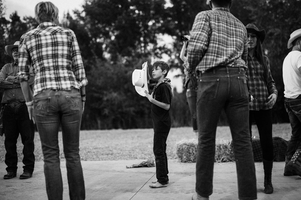 documentary-shot-of-barefoot-boy-line-dancing-in-heber-utah