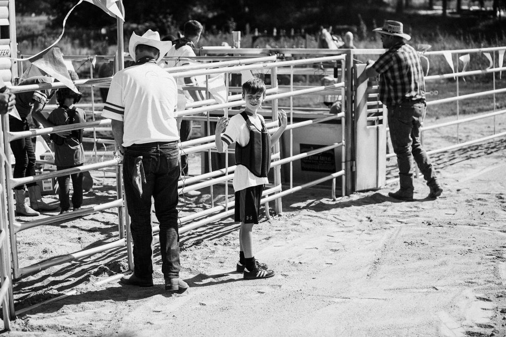 kid-getting-ready-to-ride-a-sheep-in-heber-ut