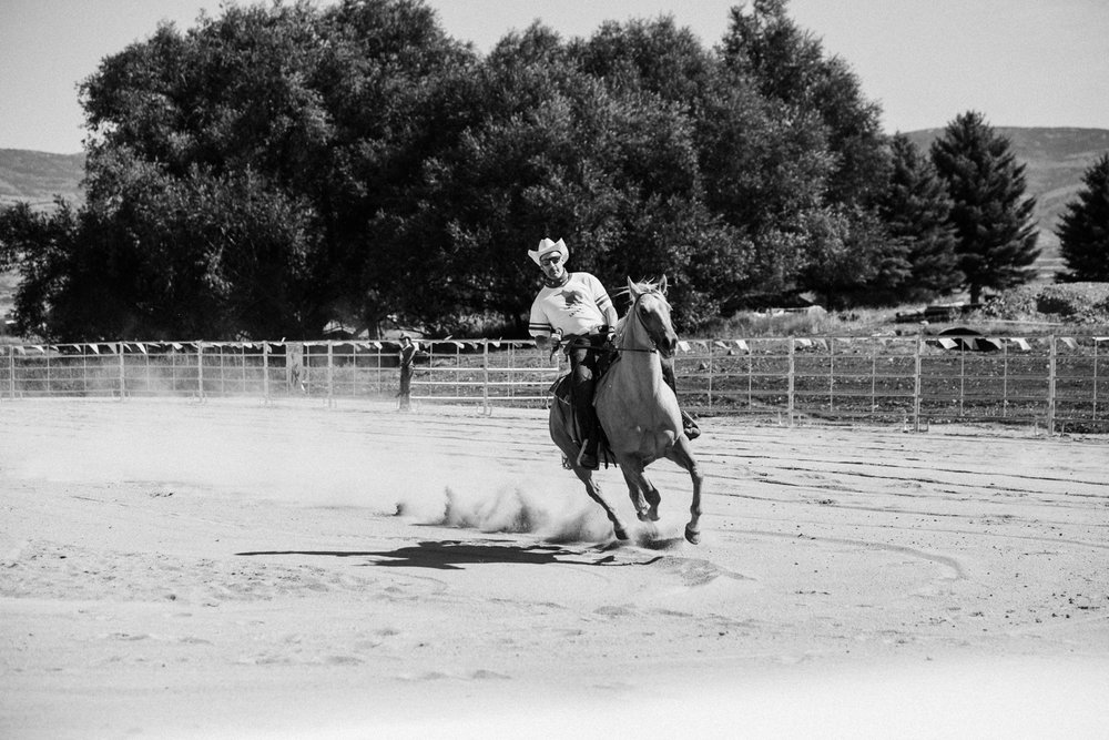 candid-shot-of-cowboy-barrel-racing-heber-ut