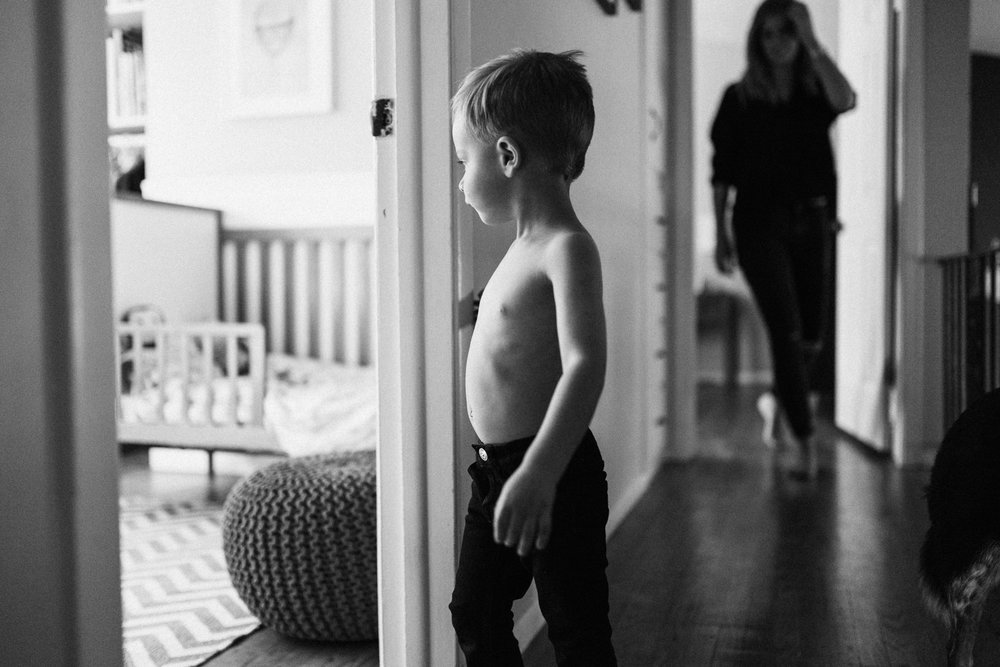 natural-black-and-white-photograph-of-boy-at-home-slc-utah