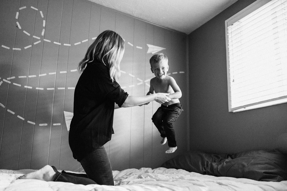 mom-and-son-jumping-on-bed-at-home-family-photographer-murray-ut