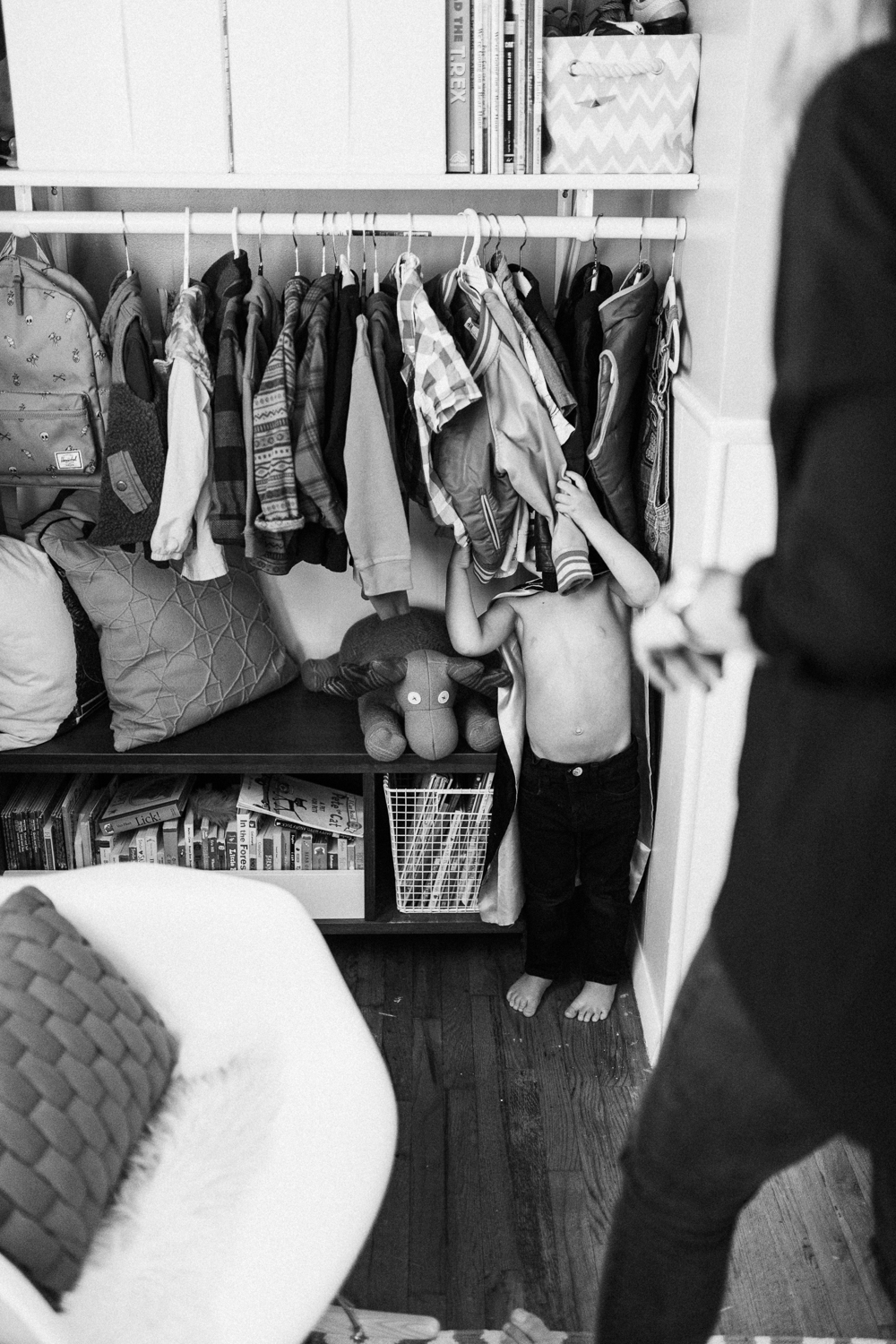 little-boy-hiding-in-closet-at-home-slc-utah