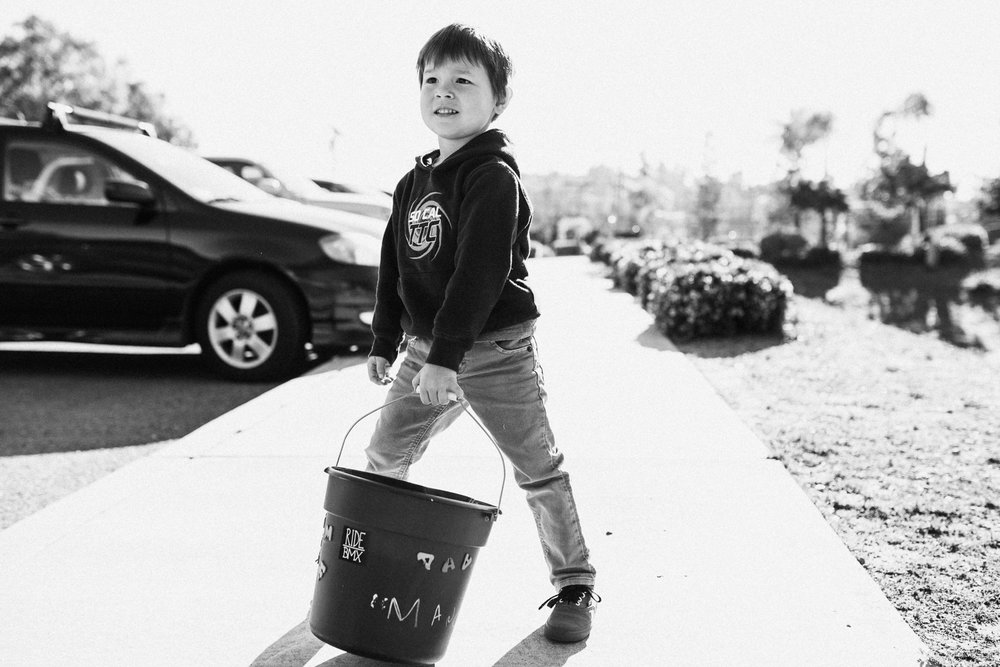 young-boy-with-bucket-at-school-san-diego-california
