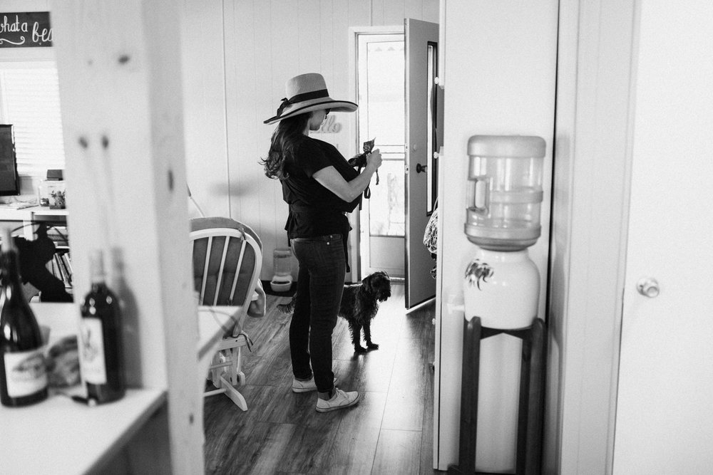 candid-black-and-white-photo-of-mom-taking-dog-for-a-walk-poway-ca