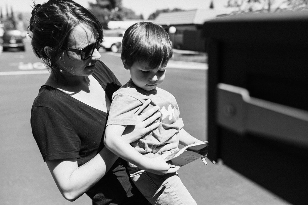 mom-and-son-getting-mail-family-photojournalism-in-san-diego-california