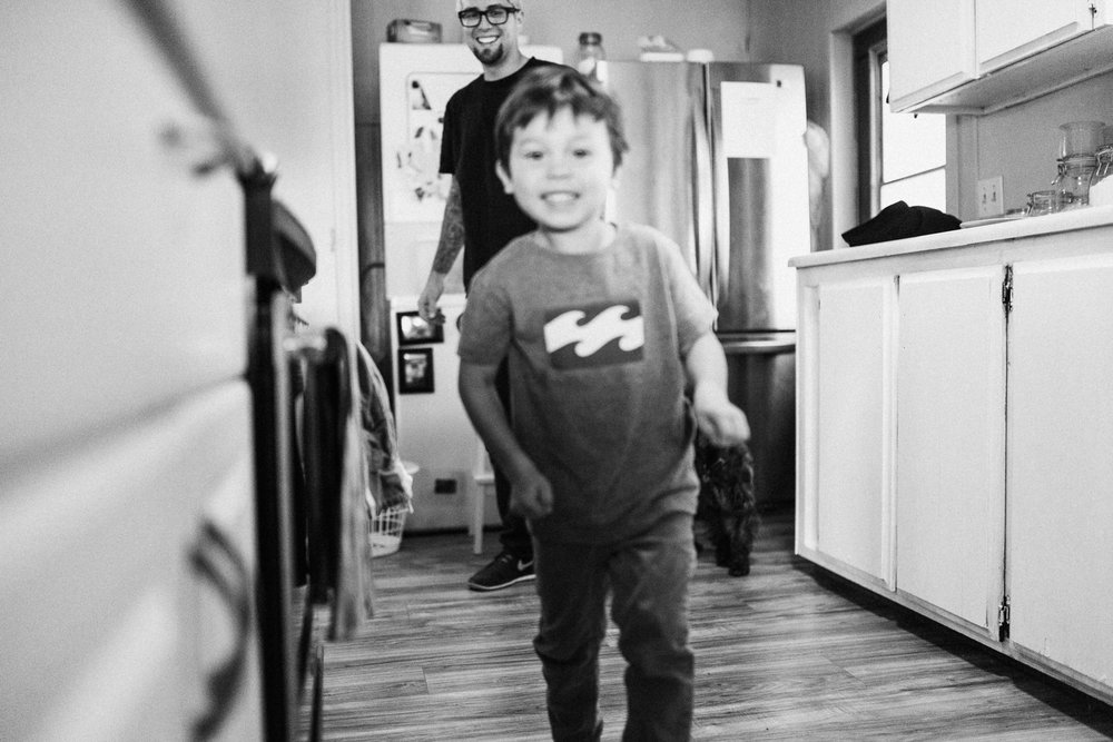 boy-running-at-camera-at-home-photo-session-poway-ca
