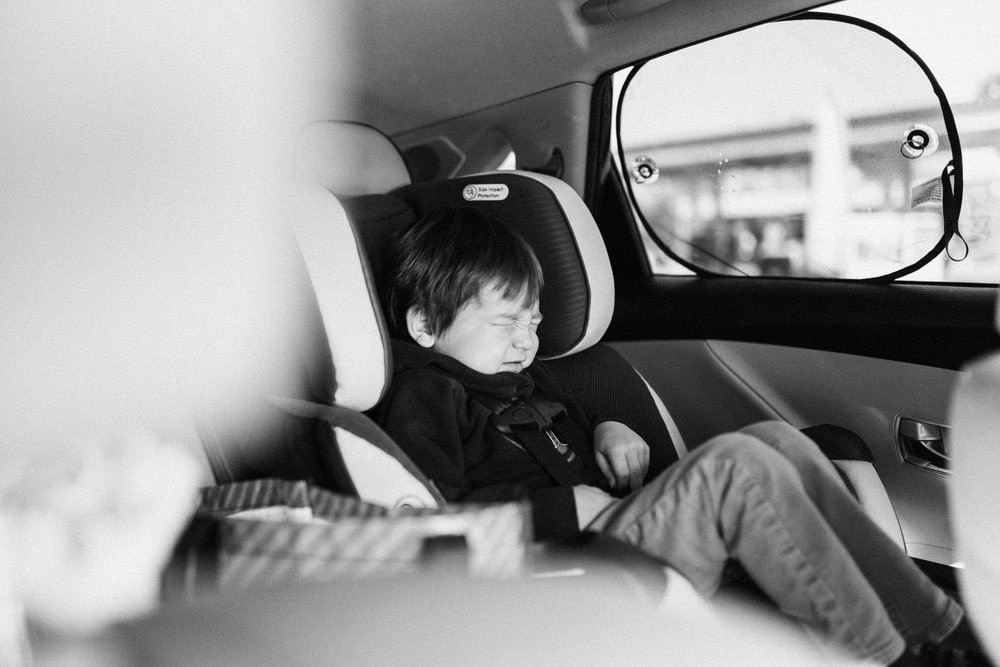 candid-image-of-young-boy-in-car-seat-poway-ca