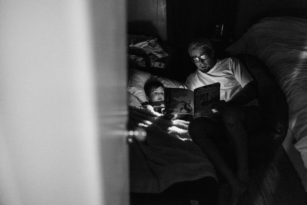 dad-and-son-reading-book-at-bedtime-poway-california