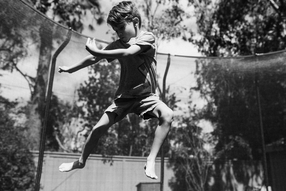 candid-photo-of-boy-on-trampoline-newport-beach-ca