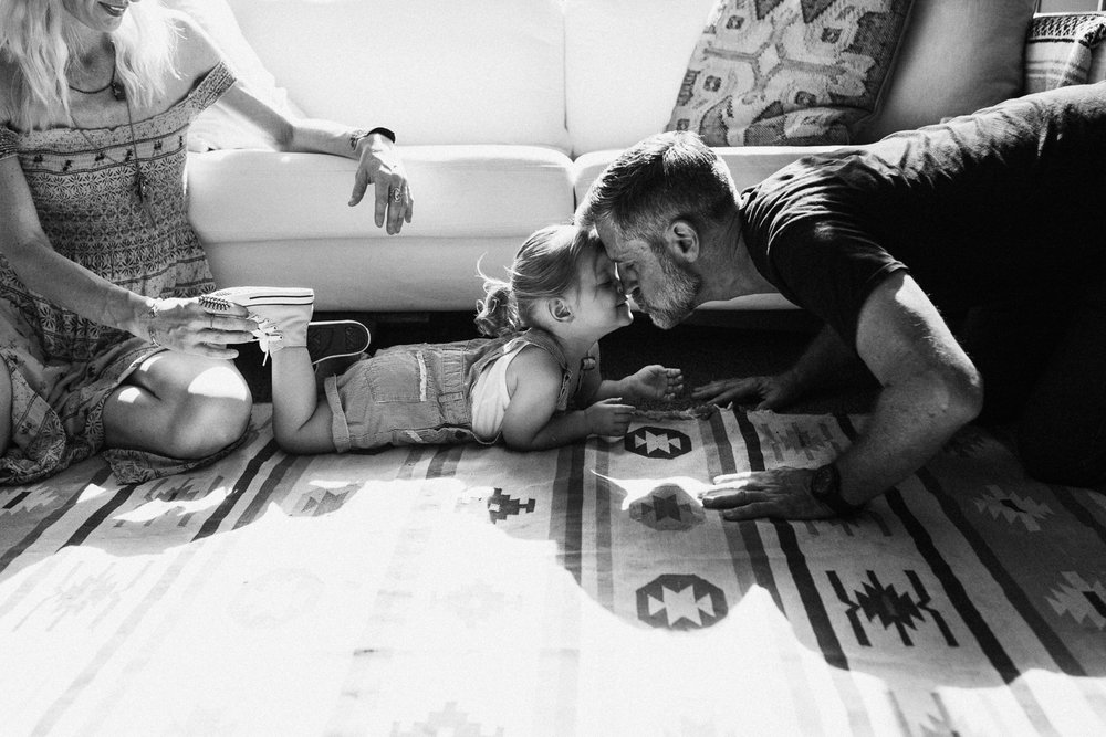 tender-and-artistic-photograph-of-dad-kissing-daughter-at-home-family-photography-by-jen-fairchild-slc-utah