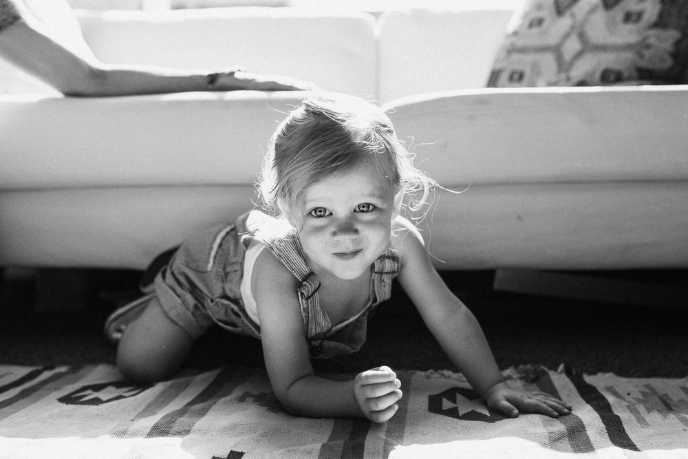 black-and-whit-portrait-of-two-year-old-little-girl-in-home-photography-session-with-jen-fairchild-slc-utah