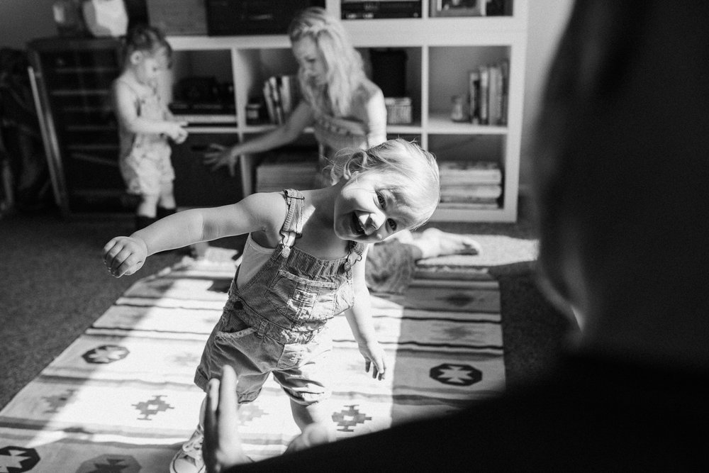 candid-and-natural-photograph-of-two-year-old-playing-with-dad-during-in-home-lifestyle-photography-session-with-jen-fairchild-salt-lake-city-utah