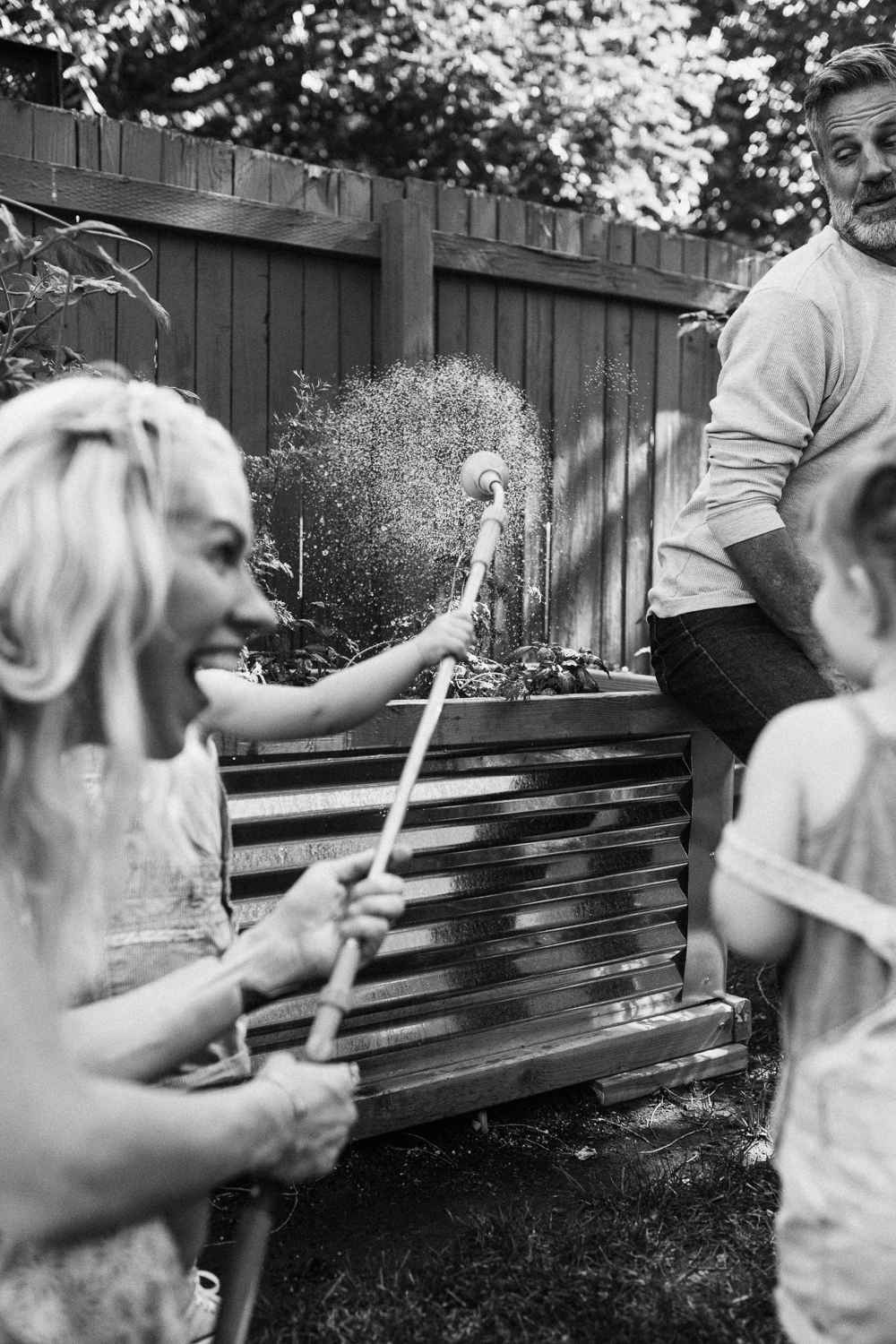 candid-photo-of-family-in-garden-at-home-during-lifestyle-photo-session-with-jen-fairchild-photography-salt-lake-city-utah