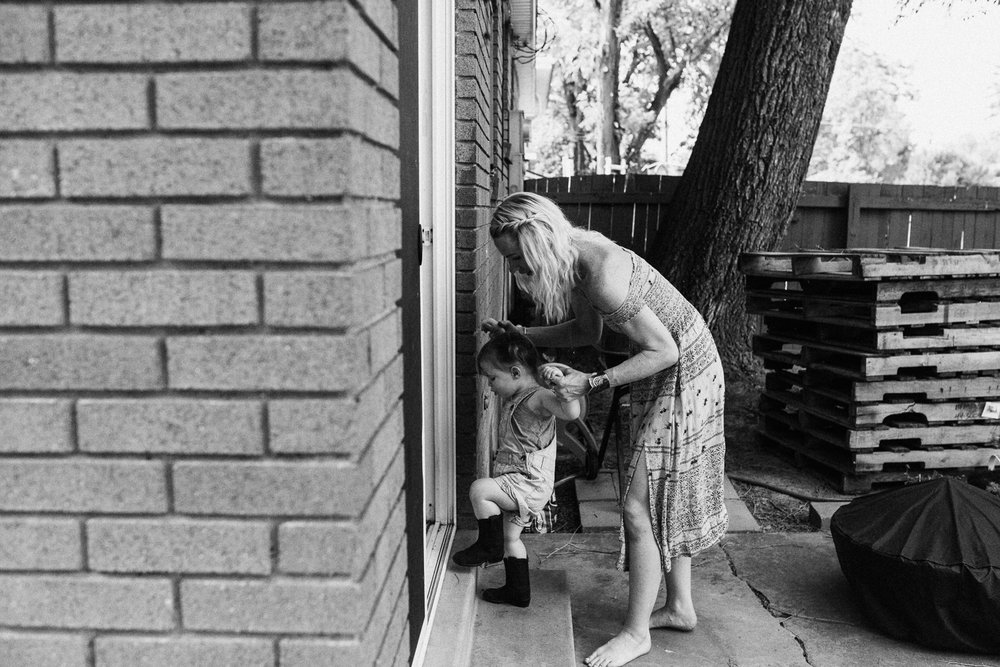 tender-shot-of-mother-helping-daughter-up-the-stairs-by-jen-fairchild-photography-slc-utah