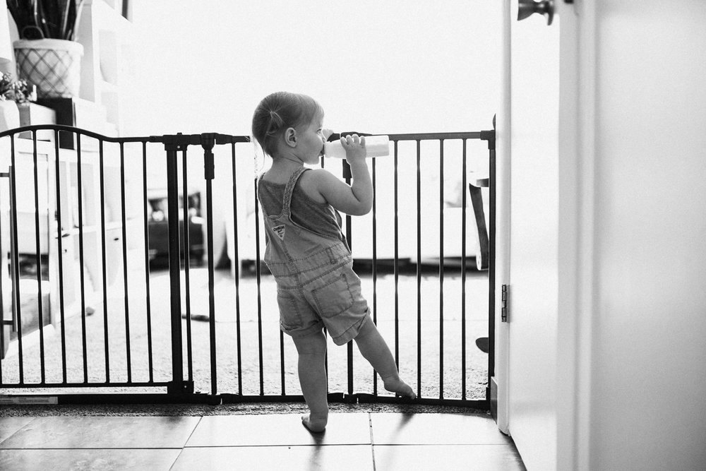 natural-and-artistic-photo-of-toddler-with-bottle-at-home-during-in-home-lifestyle-session-with-jen-fairchild-salt-lake-city-utah