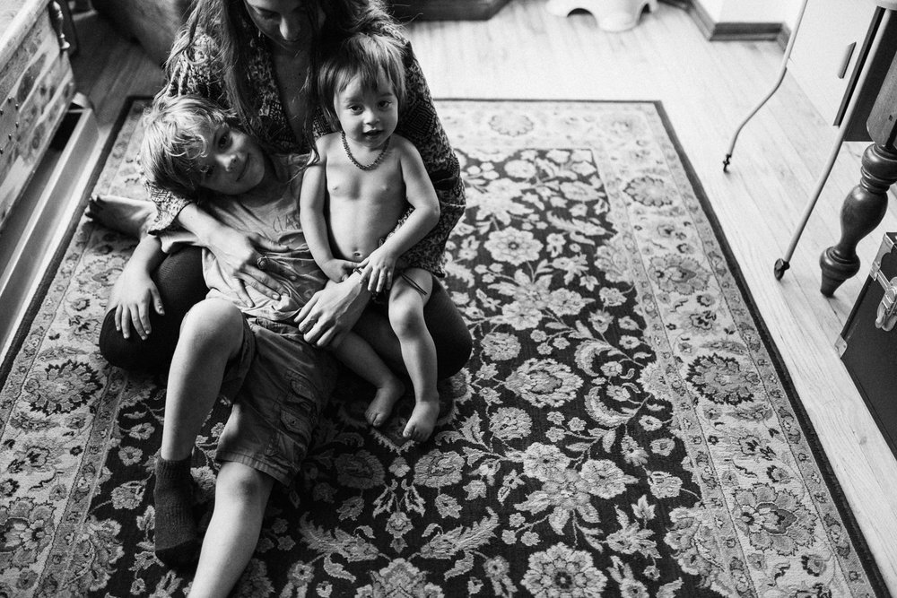 mother-hugging-and-holding-children-in-living-room-photo-session-with-jen-fairchild-photography-salt-lake-city-utah