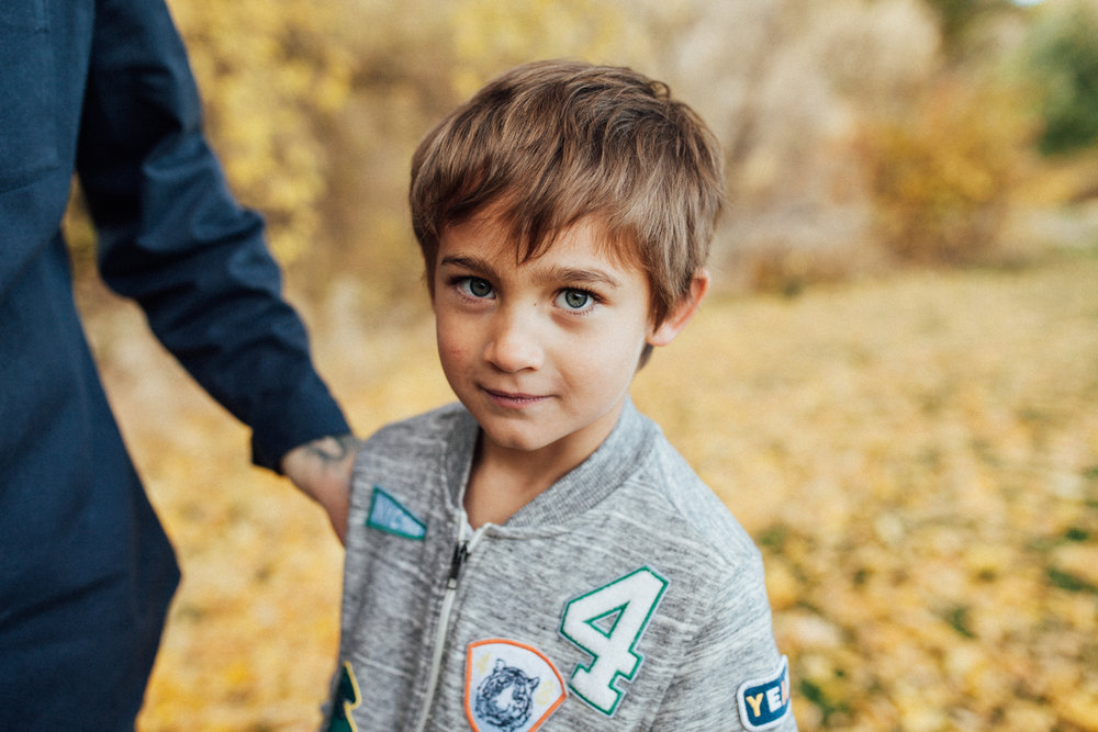 natural-and-candid-portrait-of-boy-looking-at-camera-free-family-session-with-jen-fairchild-at-rotary-glenn-park-in-salt-lake-utah