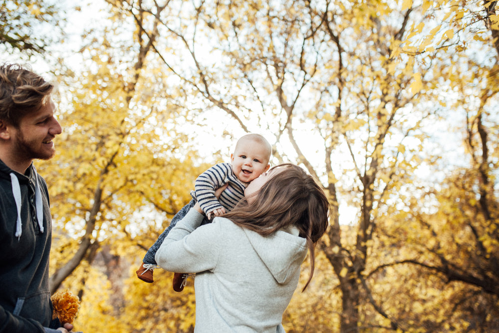 candid-and-natural-family-portrait-in-fall-leaves-during-free-mini-session-with-jen-fairchild-photography-slc-utah