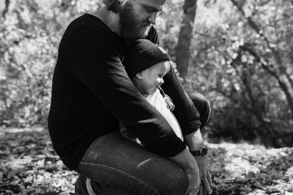 black-and-white-bearded-father-and-daughter-playing-in-fall-leaves-during-free-mini-session-with-jen-fairchild-photography-salt lake city-utah