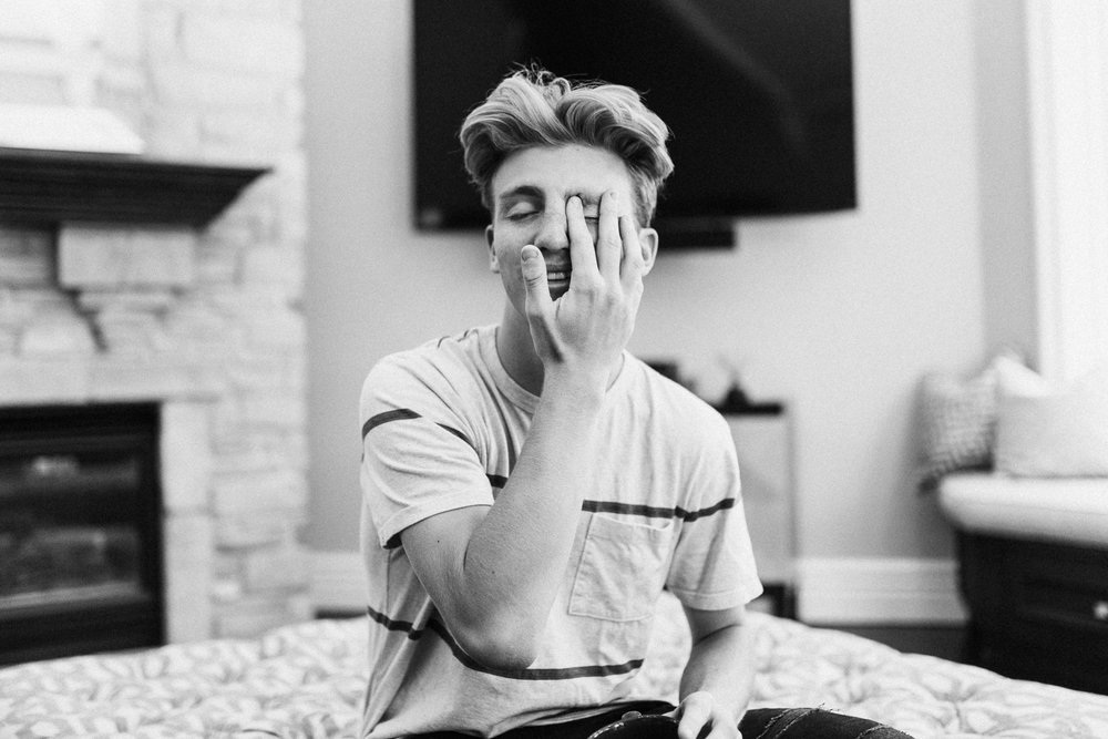 candid-natural-artistic-portrait-of-boy-rubbing-eye-saltlakecity-utah