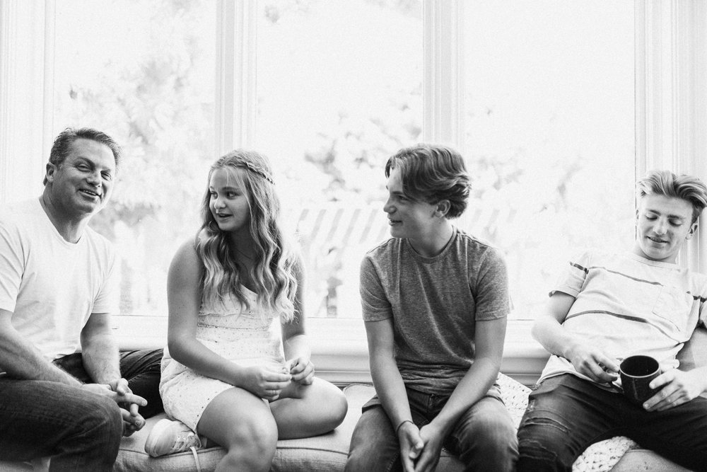 black-and-white-candid-photo-of-father-and-children-during-in-home-family-session-with-jenfairchild-photography-slc-ut
