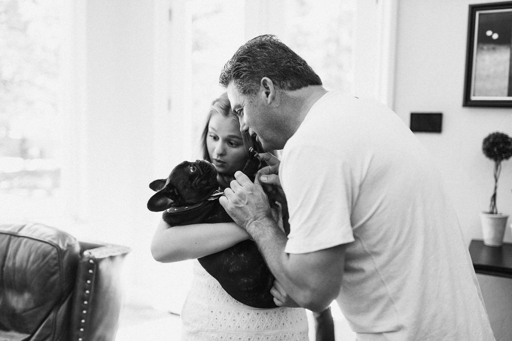 black-and-white-photo-of-father-and-daughter-with-pug-dog-slc-ut