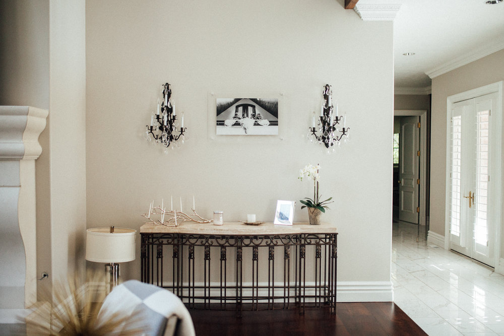 AFTER - Custom acrylic piece plays nicely off the elegance of the sconces and adds a personal touch to the room