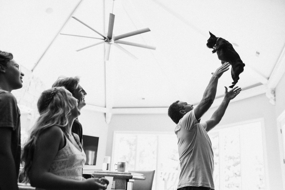 natural-and-artistic-family-throwing-dog-in-air-slc-ut