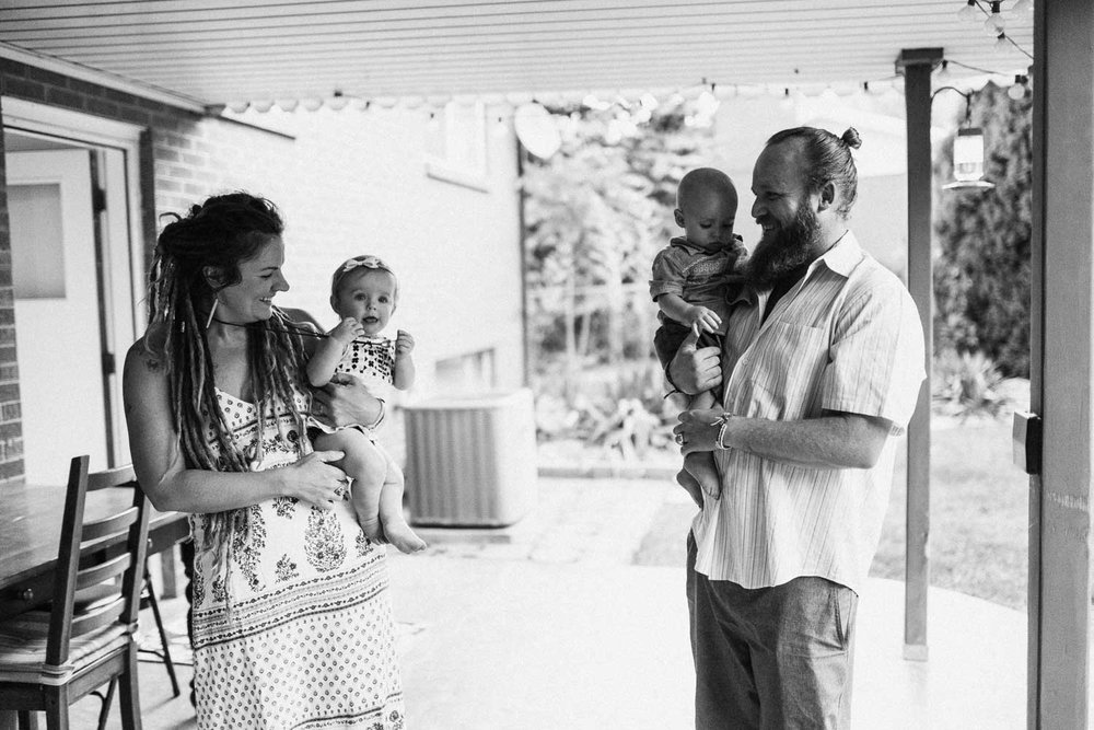 natural-and-artistic-black-and-white-photo-of-parents-holding-children