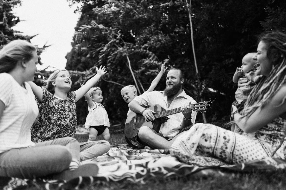 natural-and-artistic-hippie-family-singing-and-playing-in-backyard-salt-lake-city-utah