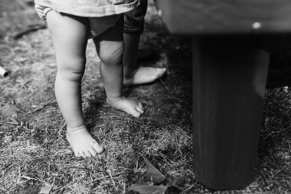 black-and-white-photo-of-baby-feet-in-grass-salt-lake-ut