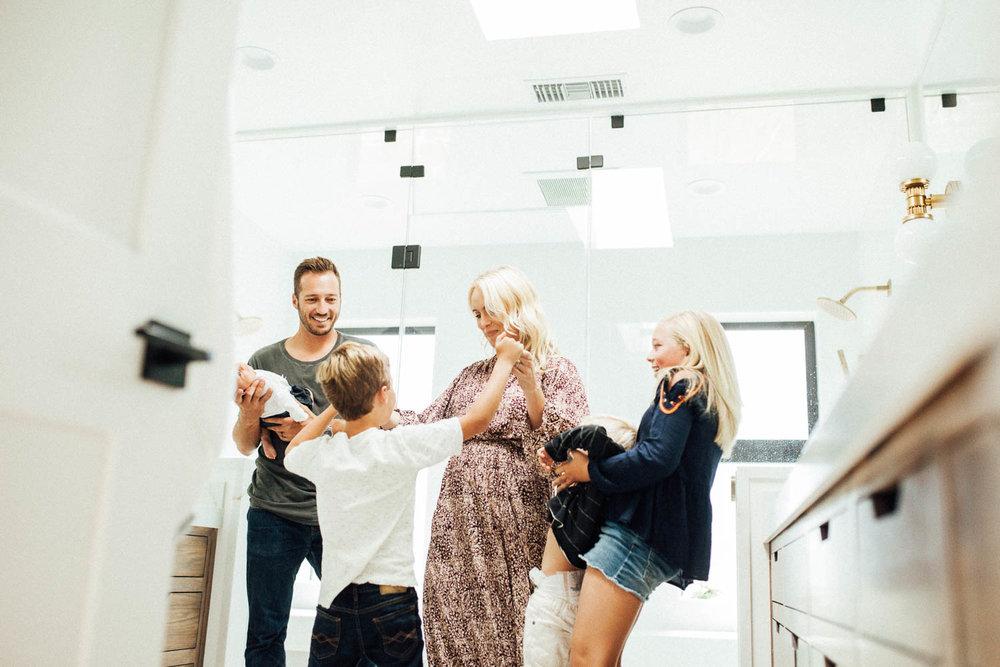 natural-and-artistic-photo-of-family-dancing-in-master-bathroom-in-encinita-ca