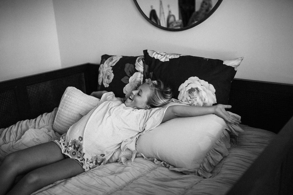 candid-black-and-white-photo-of-girl-sprawled-out-on-bed-encinita-cali