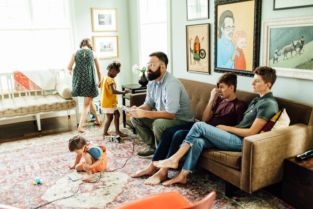 natural-and-artisitc-photo-of-family-playing-video-games-in-living-room-slc-utah