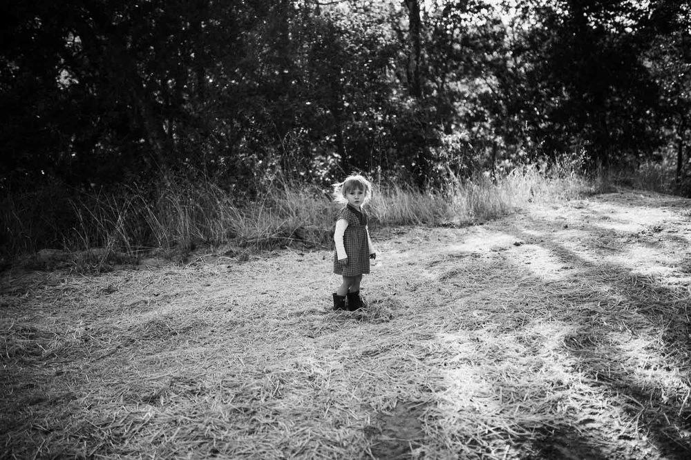 candid-black-and-white-peaceful-moment-of-little-girl-adventuring-in-nature-garberville-ca