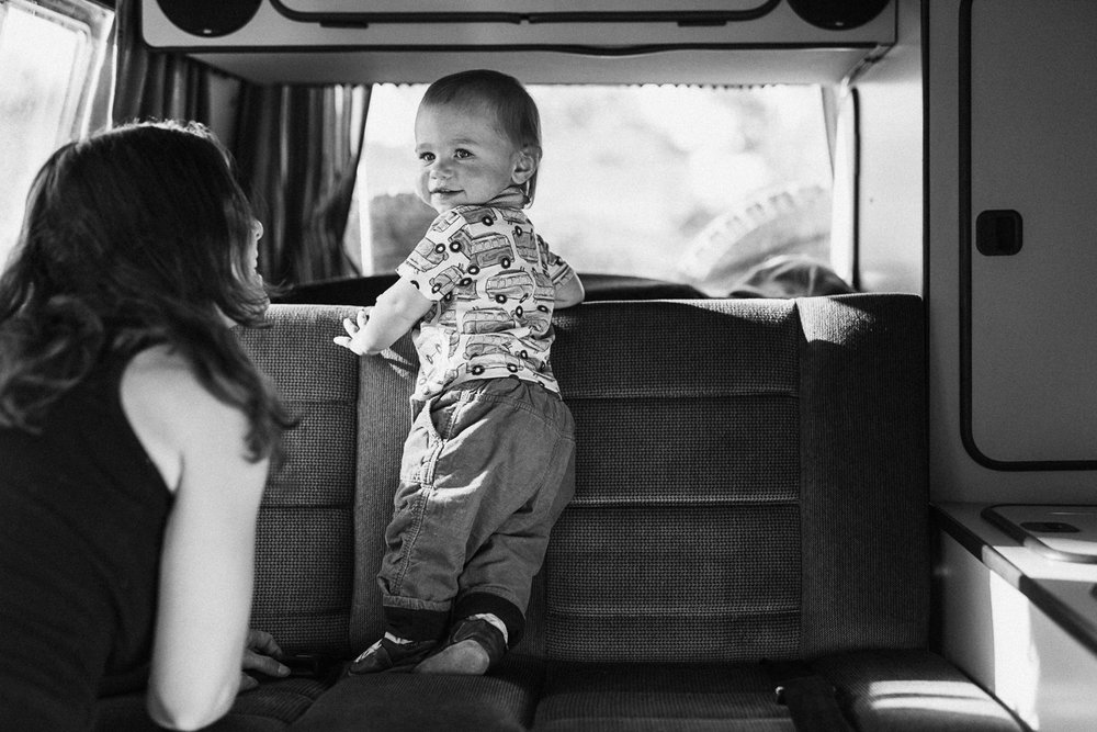 candid-black-and-white-photo-of-mother-and-son-in-sprinter-van-holladay-utah