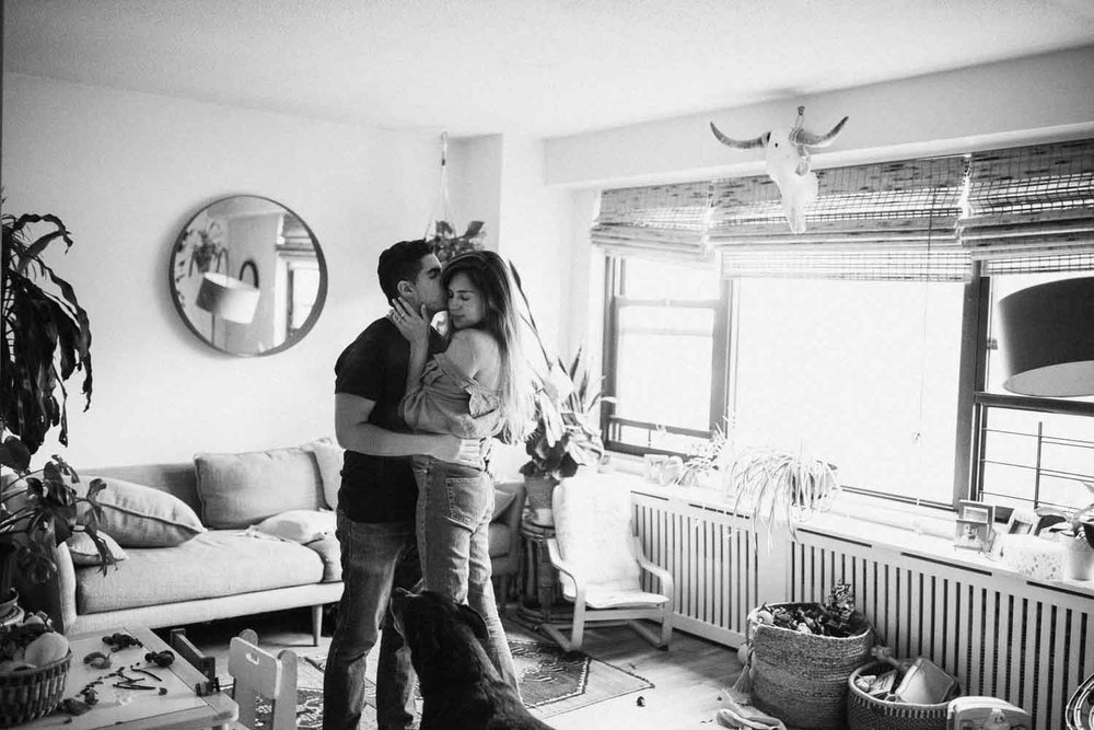 candid-intimate-loving-moment-between-husband-and-wife-in-home-ny-nyc