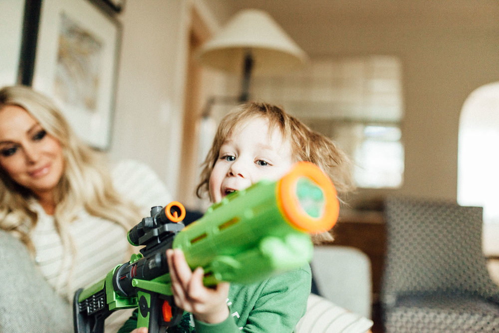 candid-bright-and-natural-photo-of-excited-boy-with-toy-gun-holladay-ut