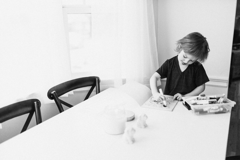 candid-black-and-white-photo-of-little-boy-coloring-slc-utah