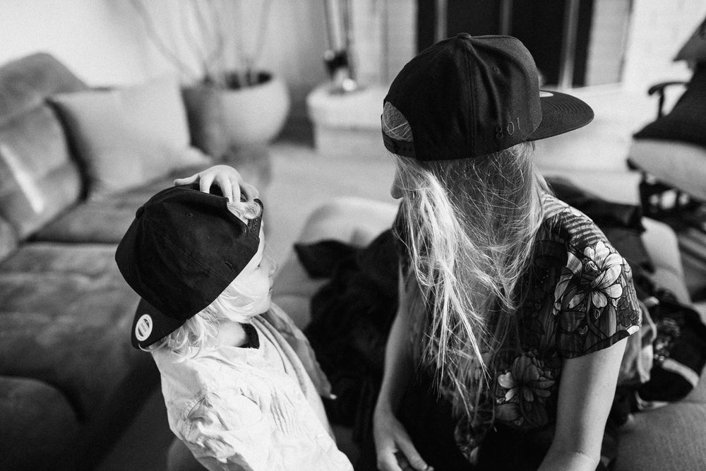 black-and-white-photo-of-mother-and-son-in-matching-snapbacks-the-notorious-slc-photo-by-jen-fairchild-photography-sugarhouse-utah