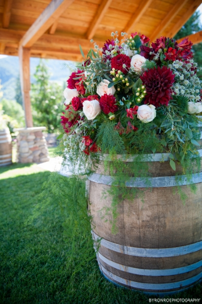 ceremony altar flowers wine barrel rustic elegance red gold flowers sophisticated floral designs portland oregon wedding florist