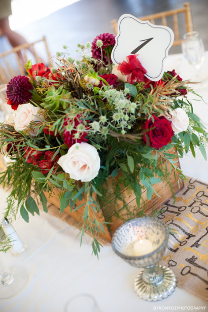 red flowers wine box centerpiece sophisticated floral designs