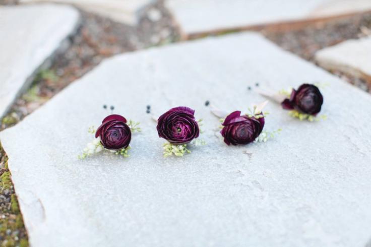 purple ranunculus boutonniere